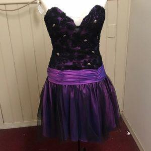 Flirty and fabulous purple and black prom dress